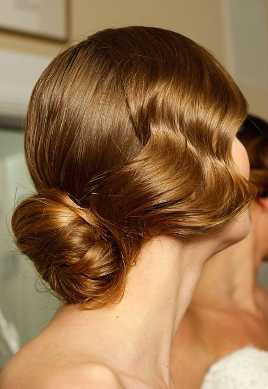 Pretty! Another Great Gatsby-inspired look–this chignon (seen at Mark Zunino's spring 2013 runway show) with its wavy locks is the idyllic look for those who want a classic hairdo with a vintage vibe.