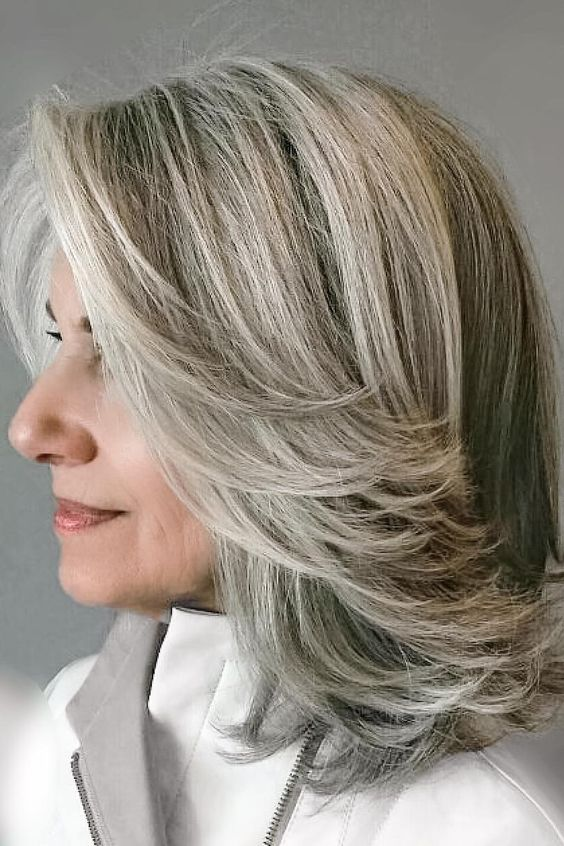 Lots of Layers | Silver is so much better than gold. Although many women dread the day they first spot a gray hair, this shade is beautiful and should be celebrated. That's right: Do. Not. Panic. Instead of rushing to the salon to color your entire head of hair, we believe you should love your natural color. Don't get caught up in believing those myths about gray hair (no, you can't go gray overnight), but rather embrace it. If you're wary of going gray or unsure about not coloring your hair