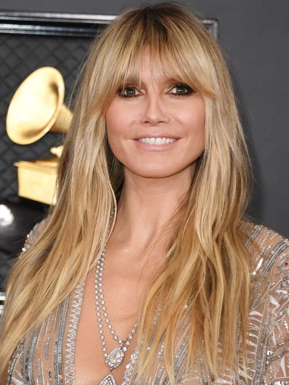 Heidi Klum — The supermodel wore her hair in long, mermaid-like waves, complete with a face-framing fringe that hovered just above her bronzed eye makeup.